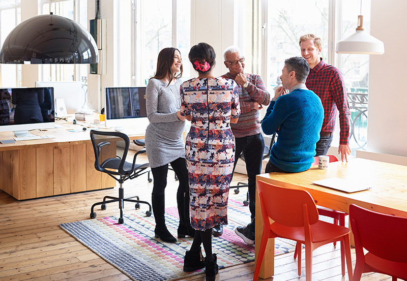 Co-workers in an informal meeting in modern office